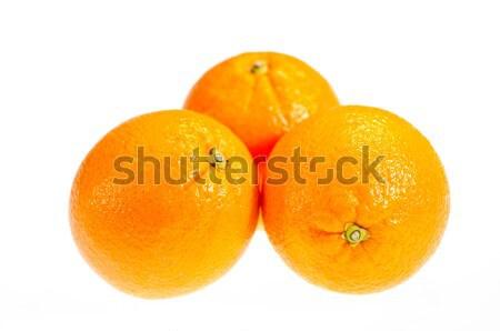 üç olgun portakal yalıtılmış beyaz arka plan Stok fotoğraf © calvste