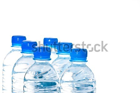 Hat ásványvíz üvegek izolált fehér közelkép Stock fotó © calvste