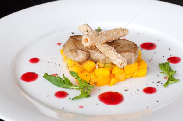 Pan seared foie gras on ripe mango Stock photo © calvste