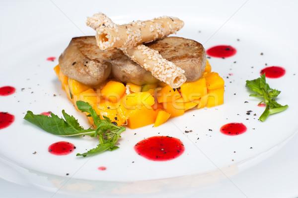 Pan seared foie gras on ripe mango close up Stock photo © calvste