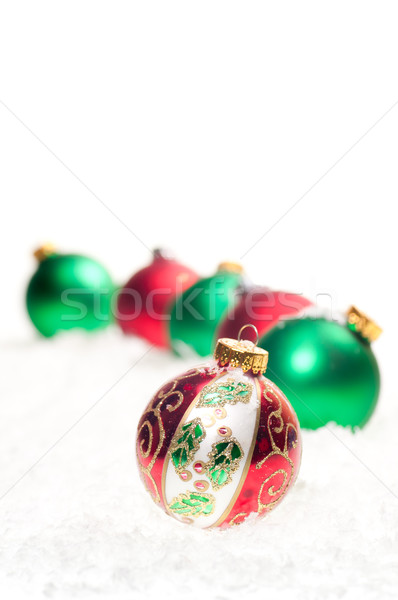 Red, green and colourful Christmas  baubles on snow Stock photo © calvste