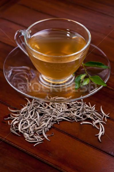 Silver tips tea on a wooden table Stock photo © calvste