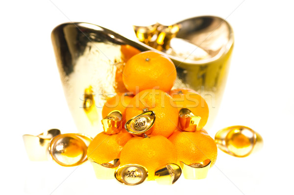 Gold ingots and tangerines close up Stock photo © calvste