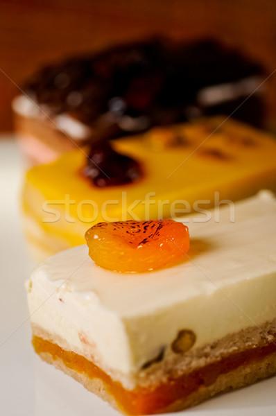 Torták szeletek három fehér tányér étel Stock fotó © calvste