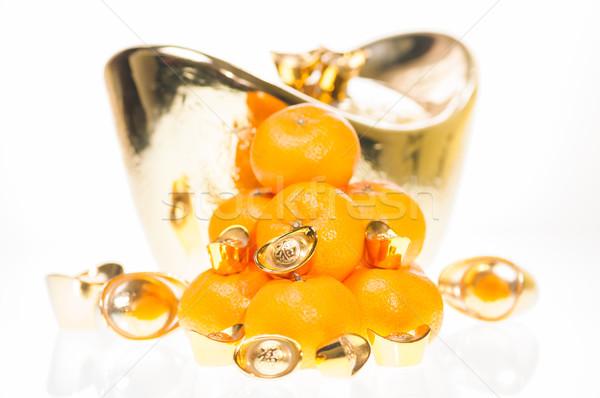 Jómódú kínai új év mandarin narancsok arany háttér Stock fotó © calvste
