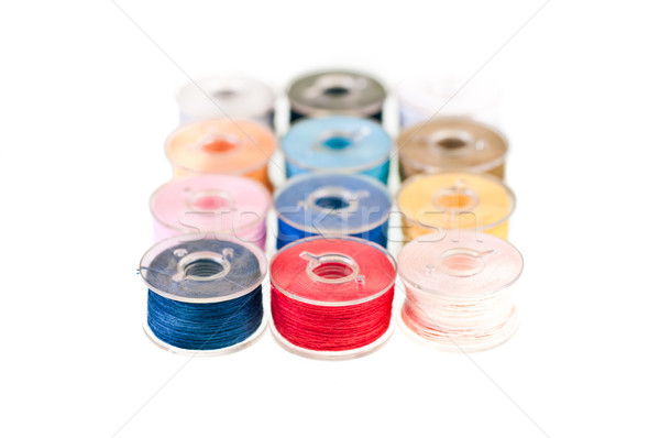 row of colorful bobbin thread Stock photo © calvste