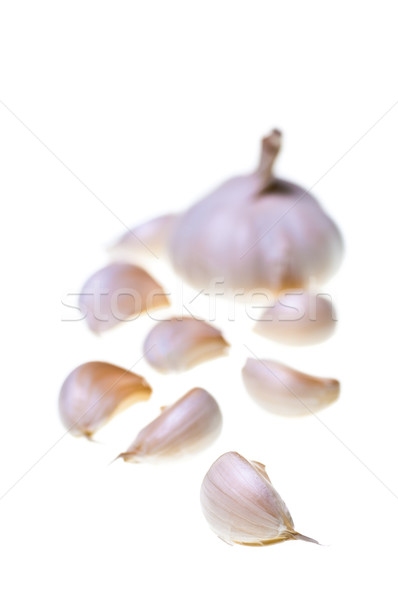 Garlic cloves with bulp and cloves as bokeh Stock photo © calvste