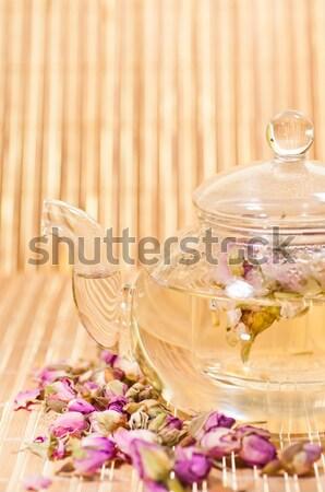Rózsaszín rózsa tea üveg teáskanna közelkép bambusz Stock fotó © calvste
