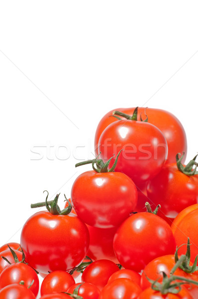 Variety of tomatoes piled up and isolated on white background Stock photo © calvste