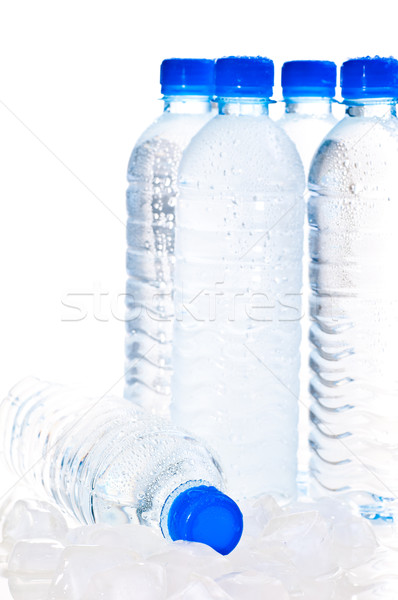 Water bottles on ice over white Stock photo © calvste