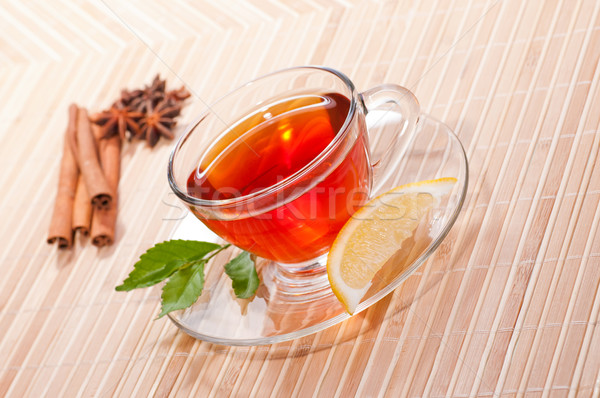 Stock photo: Hot lemon tea in a glass cup