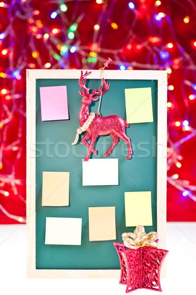 Karácsony hirdetőtábla díszek eső szarvas ajándék Stock fotó © calvste