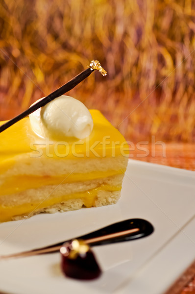 French custard cake with chocolate stick and edible gold leaf Stock photo © calvste