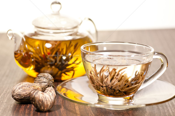 Blooming green tea in glass teacup close up Stock photo © calvste