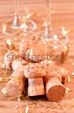 A glass of Champagne  spill over corks Stock photo © calvste