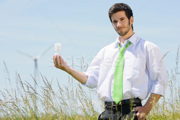 Groene energie zakenman veld houden lamp jonge Stockfoto © CandyboxPhoto