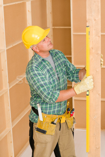 Handyman mature professional with spirit level Stock photo © CandyboxPhoto