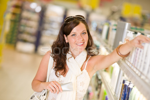 Shopping cosmetics - woman with moisturizer Stock photo © CandyboxPhoto