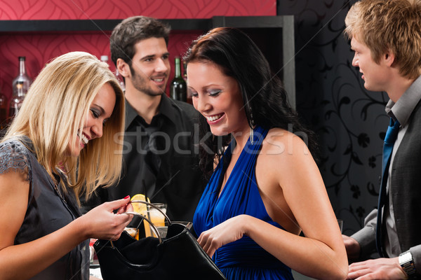 Girl friends at the bar chatting together Stock photo © CandyboxPhoto