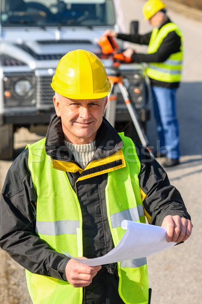 Land geodesist man hold plan reflective vest Stock photo © CandyboxPhoto