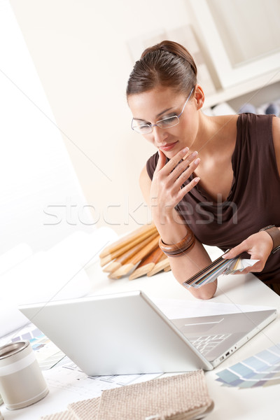 Stock photo: Smiling female designer with color swatch