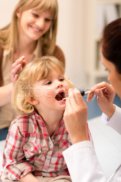 Pediatrician examine child throat look with light Stock photo © CandyboxPhoto