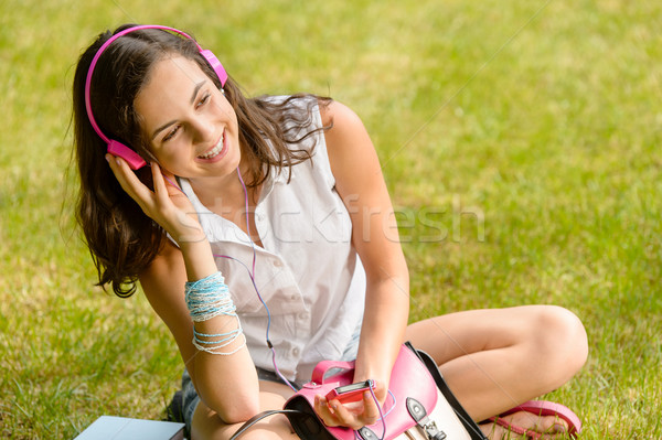 Summer student girl listen music sitting grass Stock photo © CandyboxPhoto