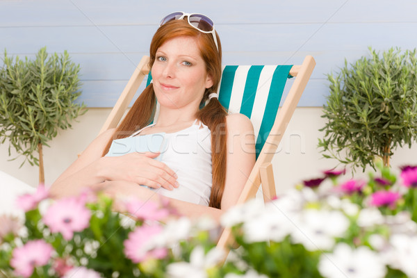 Stock photo: Summer terrace red hair woman relax in deckchair