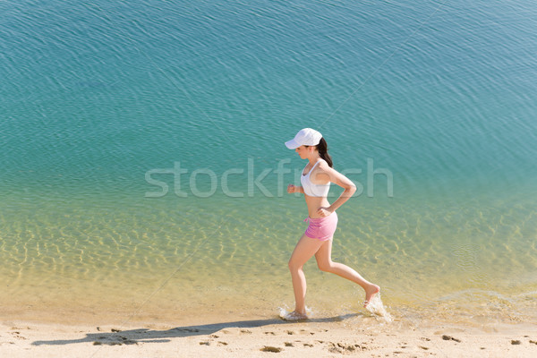 Summer sport fit woman jogging along seashore Stock photo © CandyboxPhoto