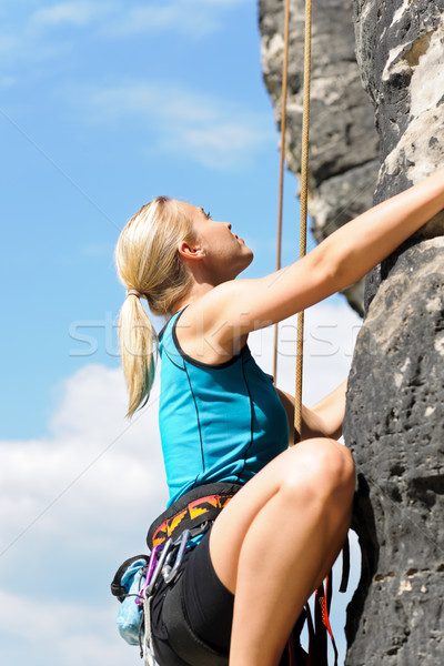 Rock climbing blond woman on rope sunny Stock photo © CandyboxPhoto