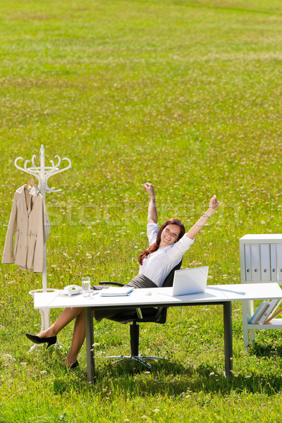 Businesswoman stretch sunny meadow nature office Stock photo © CandyboxPhoto