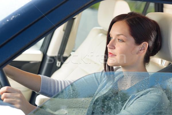 Stock photo: Attractive businesswoman drive luxury car