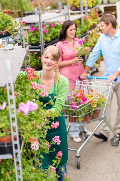 Garden center worker pushing flower shelves Stock photo © CandyboxPhoto