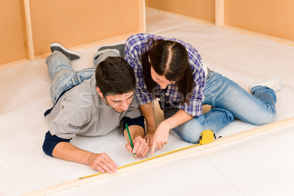 Stock photo: Home improvement young couple measure with rule