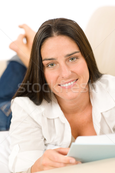 Attractive mid-aged woman read book on sofa  Stock photo © CandyboxPhoto