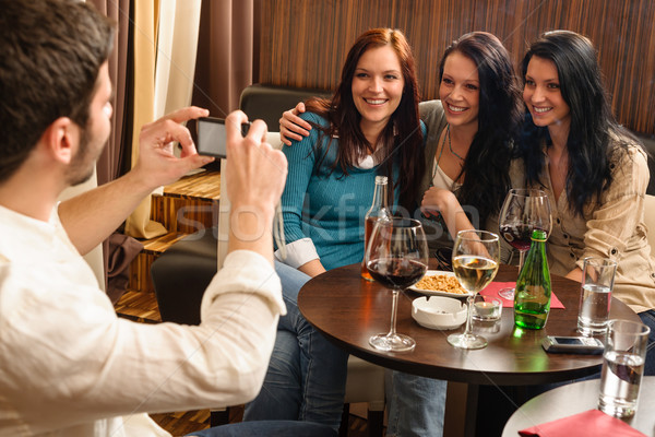 Friends at the bar man take picture Stock photo © CandyboxPhoto