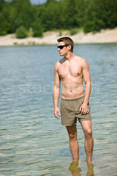 Man enjoy sun at seashore standing in water Stock photo © CandyboxPhoto