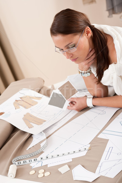 Stock photo: Female fashion designer working with sketches