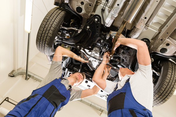Auto mechanics working underneath a car Stock photo © CandyboxPhoto