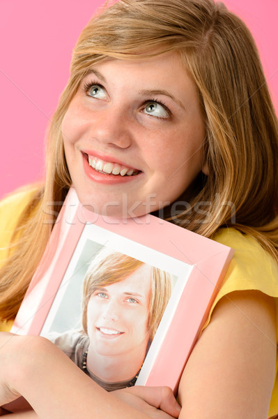 Teenage girl embracing picture of her boyfriend Stock photo © CandyboxPhoto