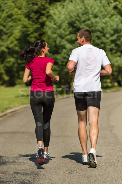 Rear view of couple friends jogging together Stock photo © CandyboxPhoto