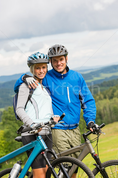 Sporty couple enjoying fresh air bicycles nature Stock photo © CandyboxPhoto