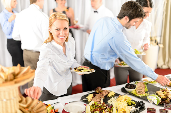 Business woman serve herself at buffet Stock photo © CandyboxPhoto