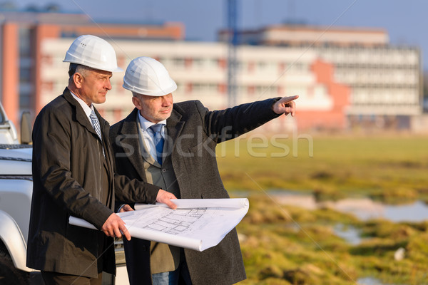 Two architects man point at construction site  Stock photo © CandyboxPhoto