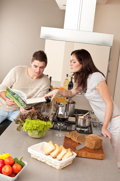Young couple cooking in kitchen together Stock photo © CandyboxPhoto