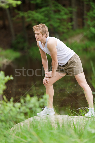 Sportive man stretching after training in nature Stock photo © CandyboxPhoto