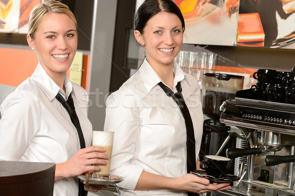 Cheerful waitresses serving hot coffee in bar Stock photo © CandyboxPhoto