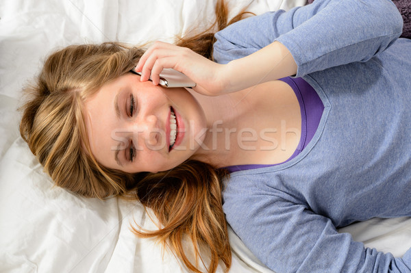 Girl lying in bed talking on phone Stock photo © CandyboxPhoto