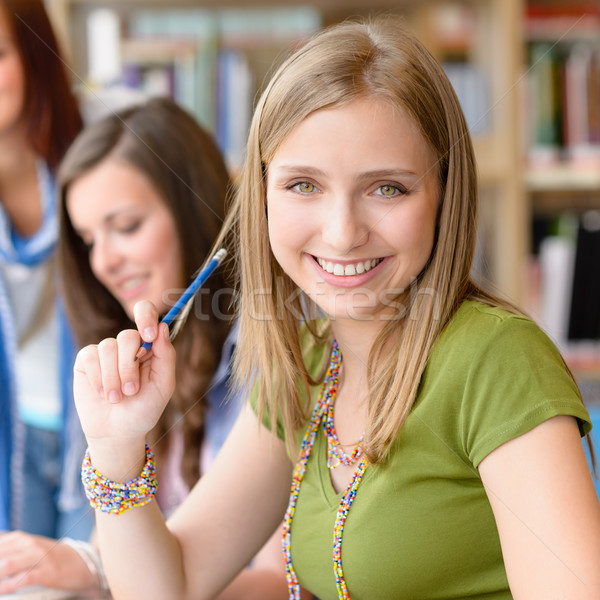 Smiling teenage student girl at study room  Stock photo © CandyboxPhoto