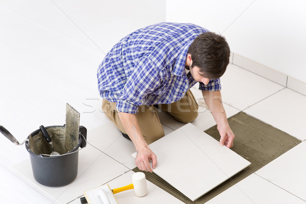 Home improvement - handyman laying tile Stock photo © CandyboxPhoto